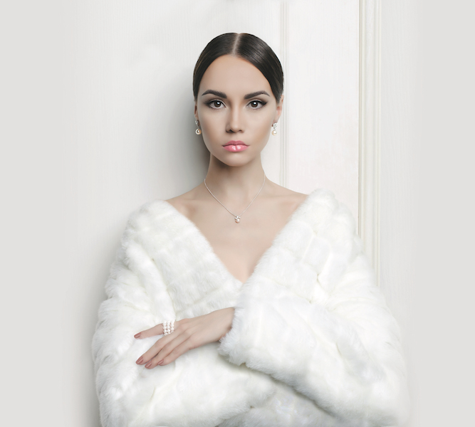 Fashion photo of beautiful lady in elegant white fur coat